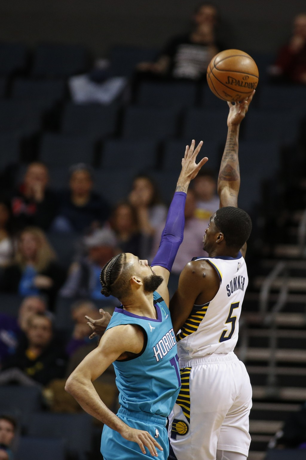 Indiana Pacers guard Edmond Sumner, right, shoots over Charlotte Hornets forward Cody Martin in the first half of an NBA basketball game in Charlotte,...