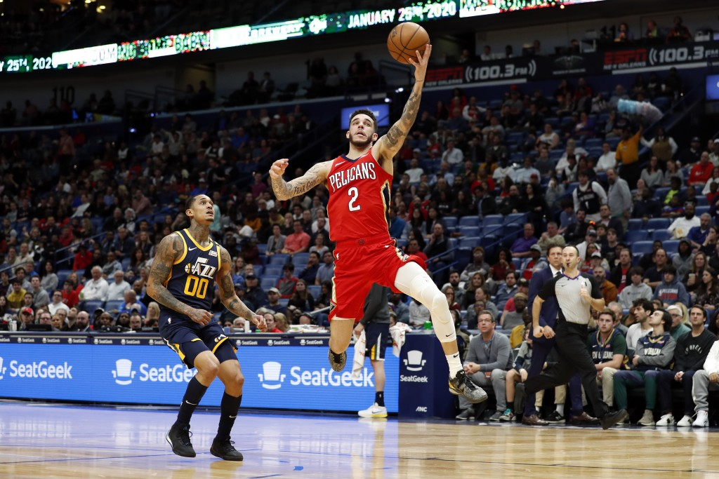 New Orleans Pelicans guard Lonzo Ball (2) catches a pass in front of Utah Jazz guard Jordan Clarkson (00) in the first half of an NBA basketball game ...