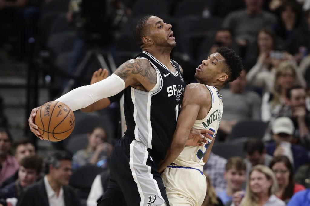 San Antonio Spurs center LaMarcus Aldridge, left, drives against Milwaukee Bucks forward Giannis Antetokounmpo, right, during the second half of an NB...