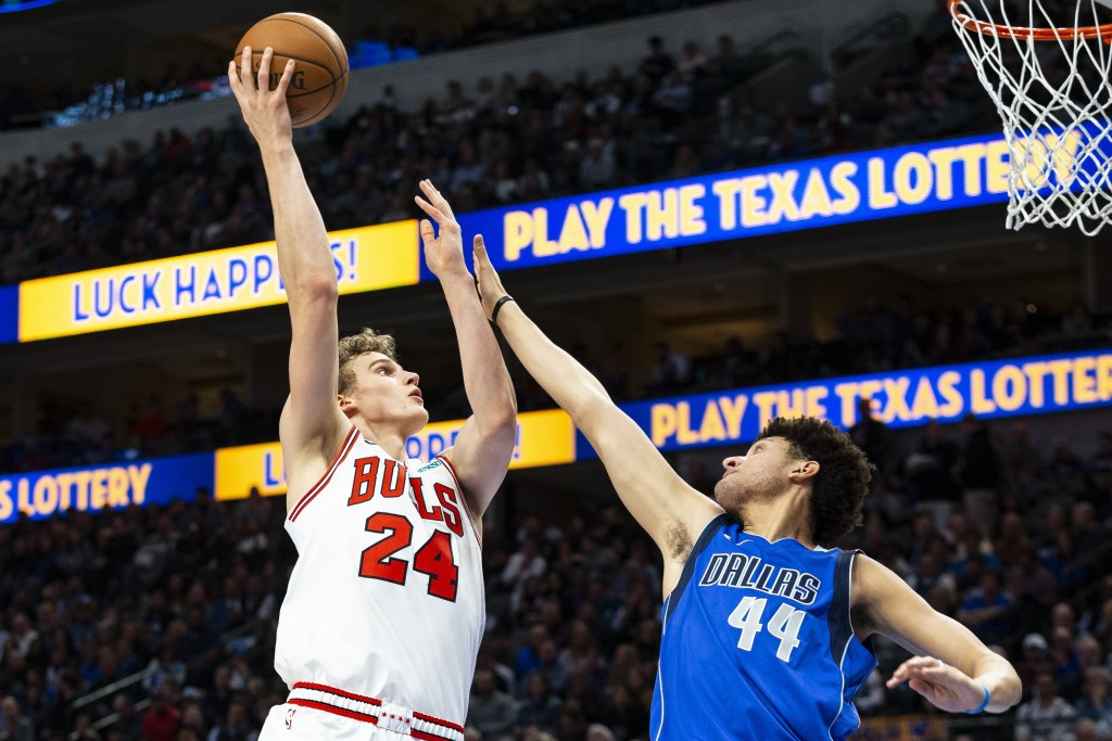 Chicago Bulls forward Lauri Markkanen (24) attempts to shoot as Dallas Mavericks forward Justin Jackson (44) defends during the first half of an NBA b...