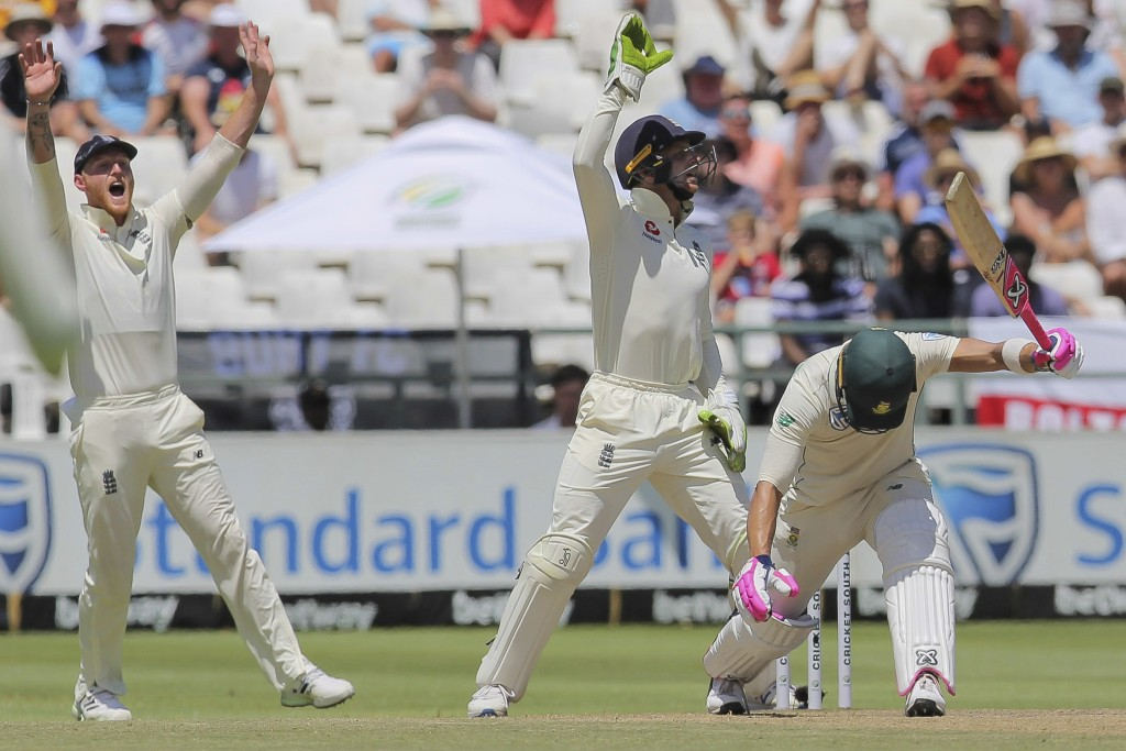 England's wicketkeeper Jos Buttler, center, and Ben Stokes, left, appeal a wicket against South African captain Faf DuPlessis during day five of the s...