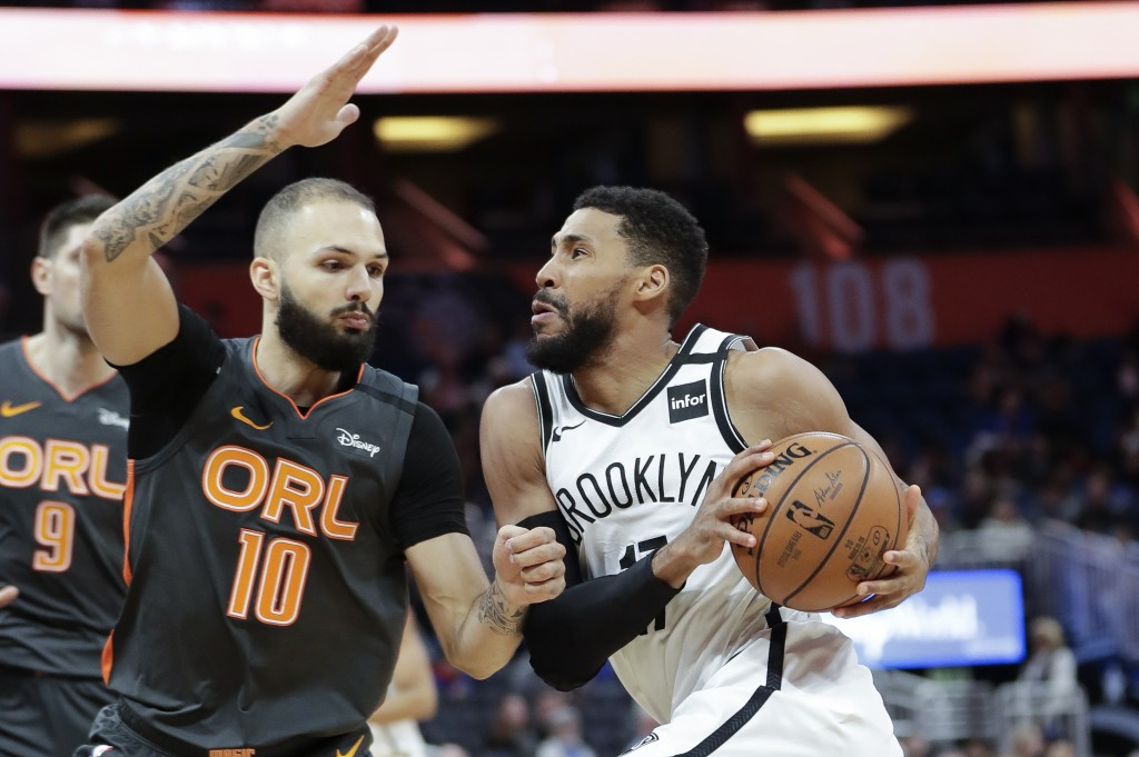 Brooklyn Nets guard Garrett Temple, right, drives to the basket against Orlando Magic guard Evan Fournier (10) during the second half of an NBA basket...