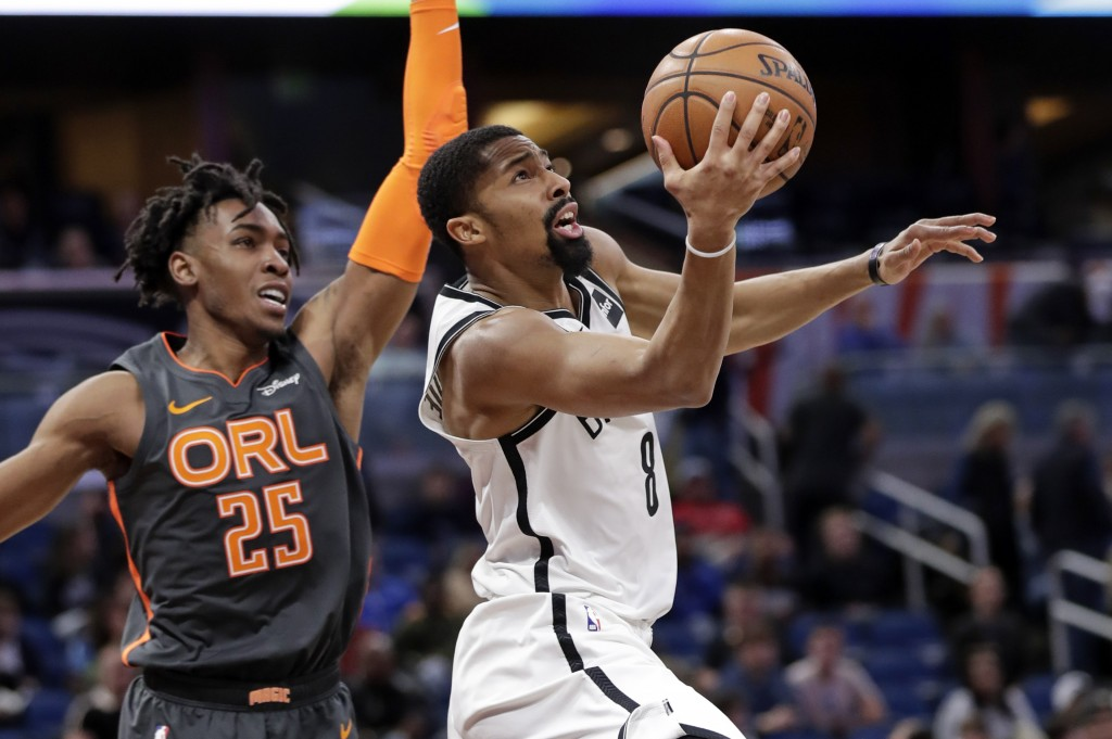 Brooklyn Nets guard Spencer Dinwiddie (8) shoots in front of Orlando Magic forward Wes Iwundu (25) during the second half of an NBA basketball game, M...