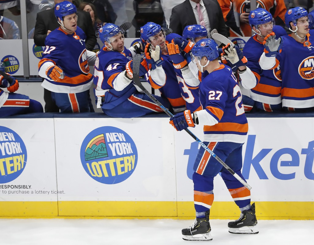 Teammates congratulate New York Islanders left wing Anders Lee (27) after Lee scored a goal against the Colorado Avalanche during the third period of ...