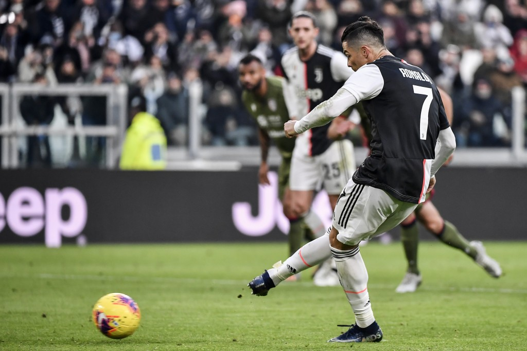 Juventus' Cristiano Ronaldo scores the second of his three goals during an Italian Serie A soccer match between Juventus and Cagliari at the Allianz S...