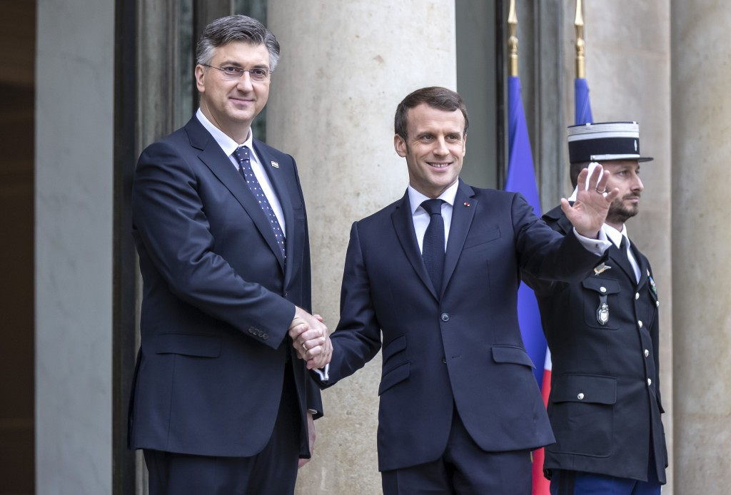 Croatian Prime Minister Andrej Plenkovic, left, is welcomed by French President Emmanuel Macron at the Elysee Palace in Paris, Tuesday, Jan. 7, 2020. ...