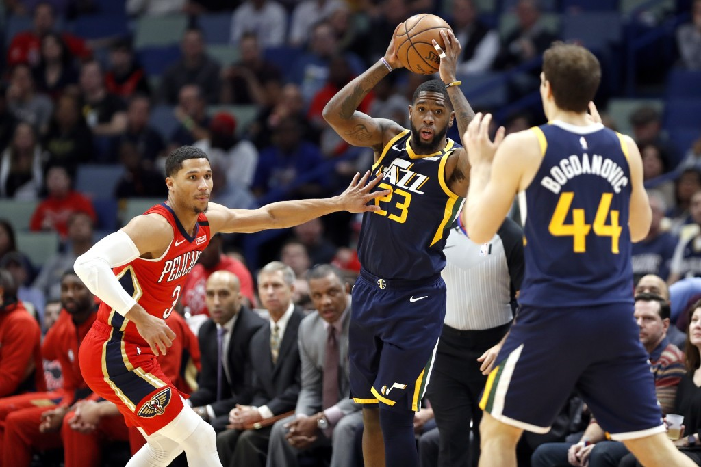 Utah Jazz forward Royce O'Neale (23) looks to pass the ball to forward Bojan Bogdanovic (44) while defended by New Orleans Pelicans guard Josh Hart (3...