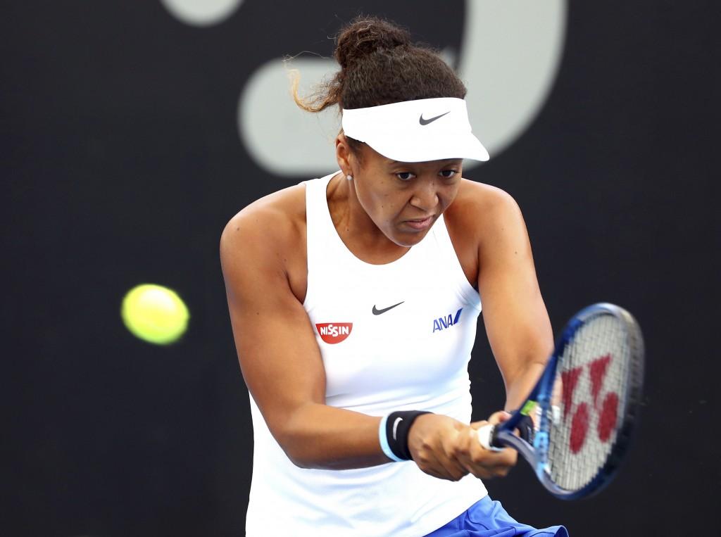 Naomi Osaka of Japan plays a shot during her match against Maria Sakkari of Greece at the Brisbane International tennis tournament in Brisbane, Austra...