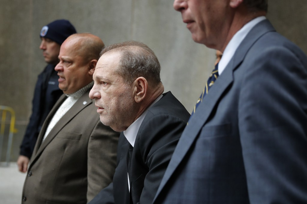 Harvey Weinstein, third from left, leaves court in New York, Monday, Jan. 6, 2020. The disgraced movie mogul faces allegations of rape and sexual assa...