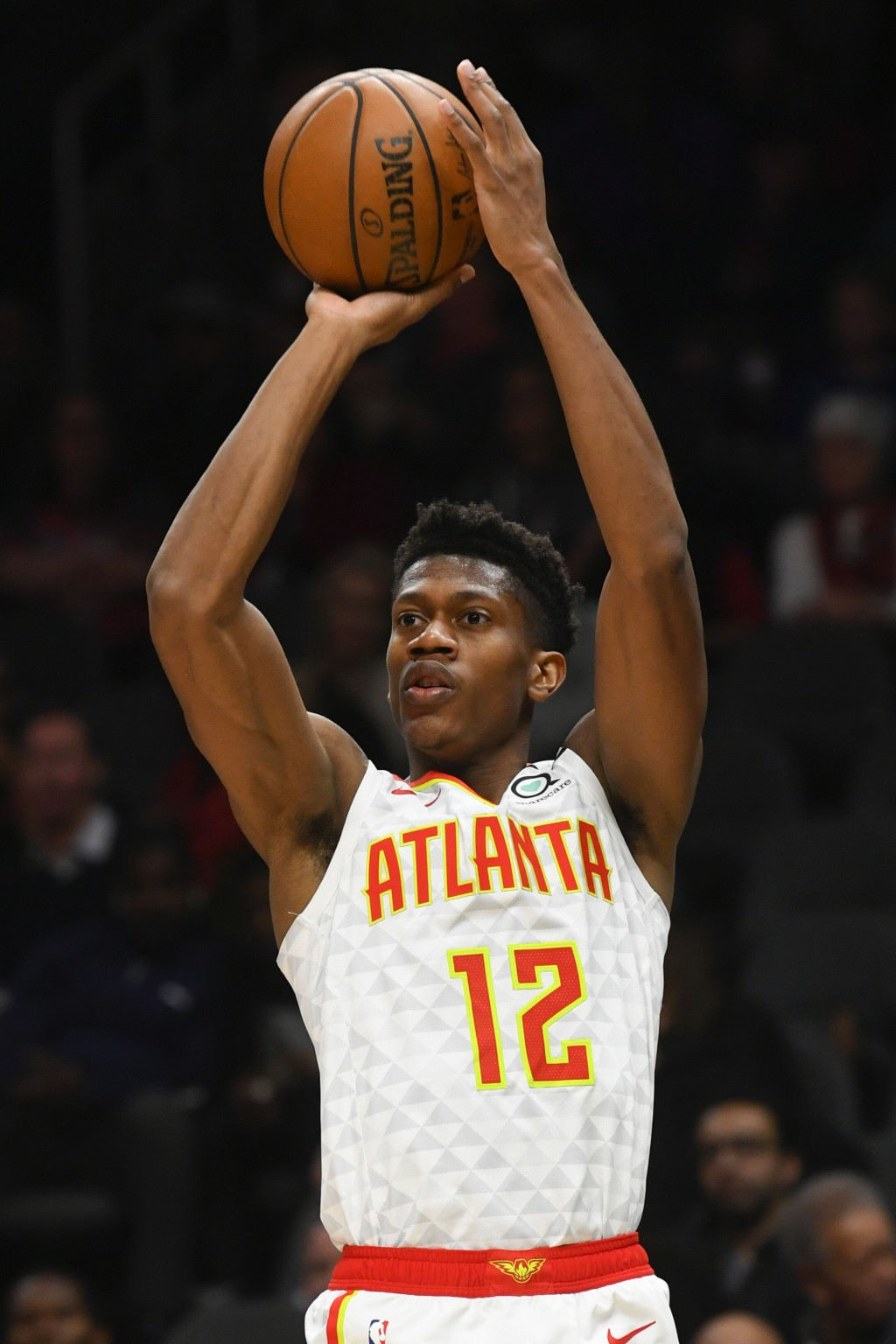 Atlanta Hawks forward De'Andre Hunter shoots during the first half of an NBA basketball game against the Denver Nuggets, Monday, Jan. 6, 2020, in Atla...