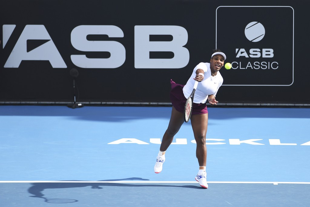 United States' Serena Williams serves during her match against Italy's Camila Giorgi at the ASB Classic in Auckland, New Zealand, Tuesday, Jan. 7, 202...