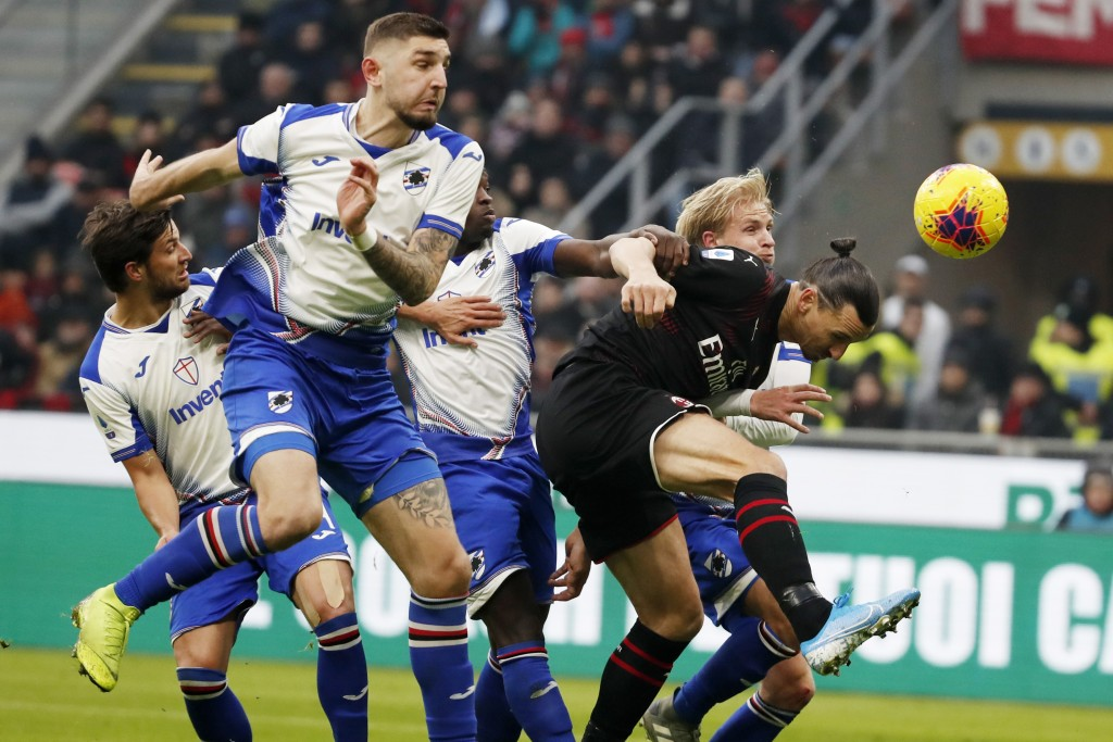 AC Milan's Zlatan Ibahimovic, left, challenges for the ball with Sampdoria's players during the Serie A soccer match between AC Milan and Sampdoria at...