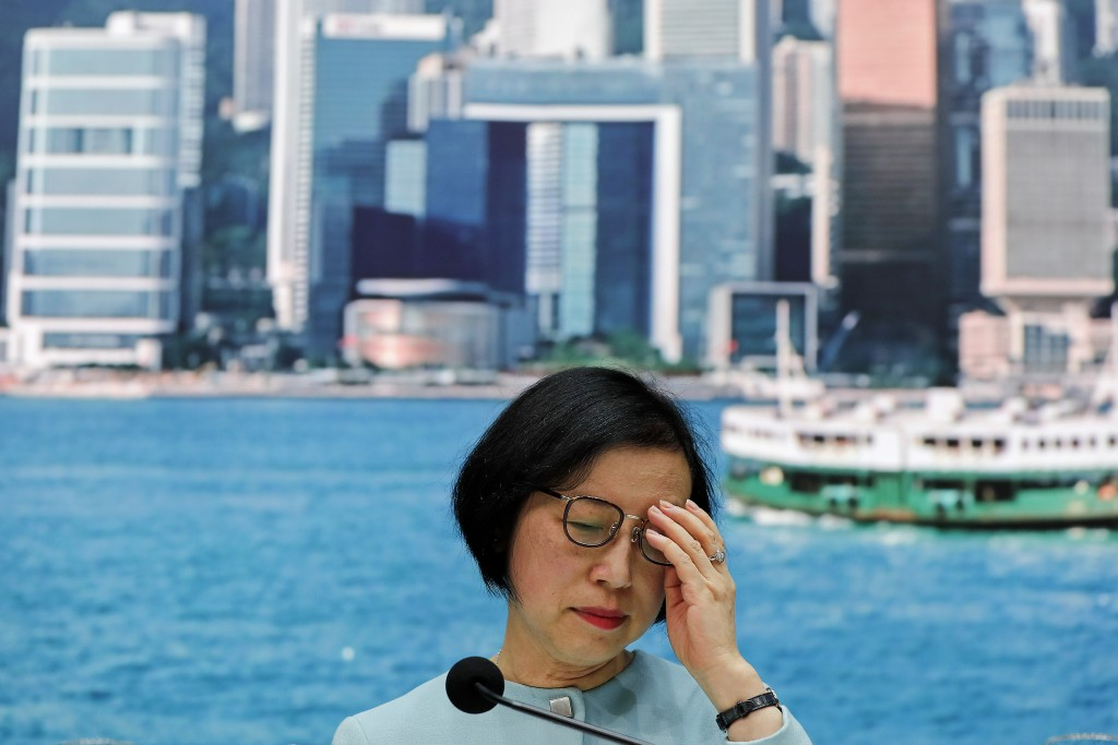 Secretary for Food and Health, Prof. Sophia Chan adjusts her glasses during a news conference at the Central Government Office in Hong Kong, Tuesday, ...