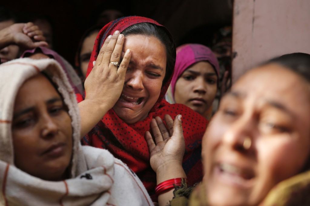 In this Tuesday, Dec. 24, 2019, photo, sister of Mohsin Ahmad, a laborer who was shot and killed allegedly in police firing during protests against Ci...