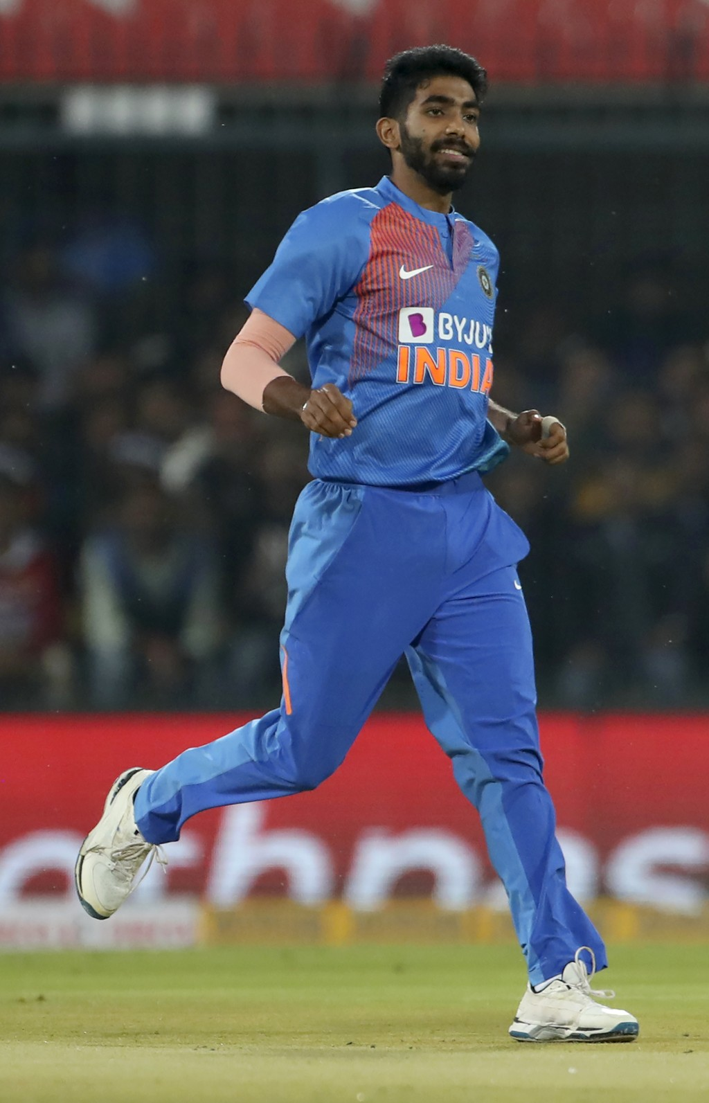 India's Jasprit Bumrah reacts after bowling a delivery during the second Twenty20 international cricket match between India and Sri Lanka in Indore, I...