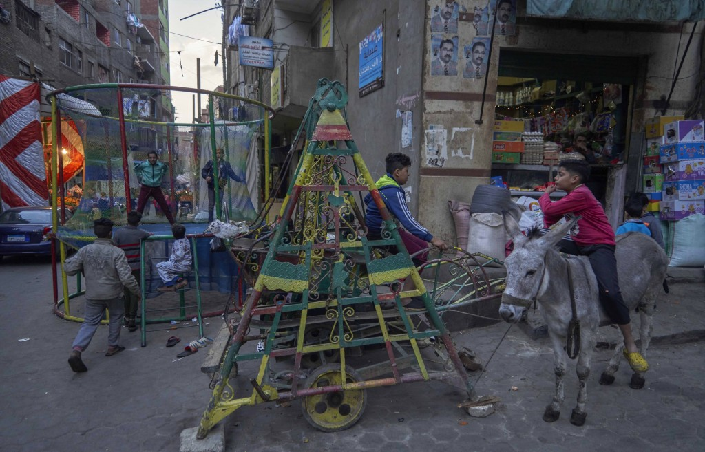 Coptic children play in a makeshift playground during their vacation for Coptic Christmas, at a residential and industrial area of eastern Cairo, Egyp...