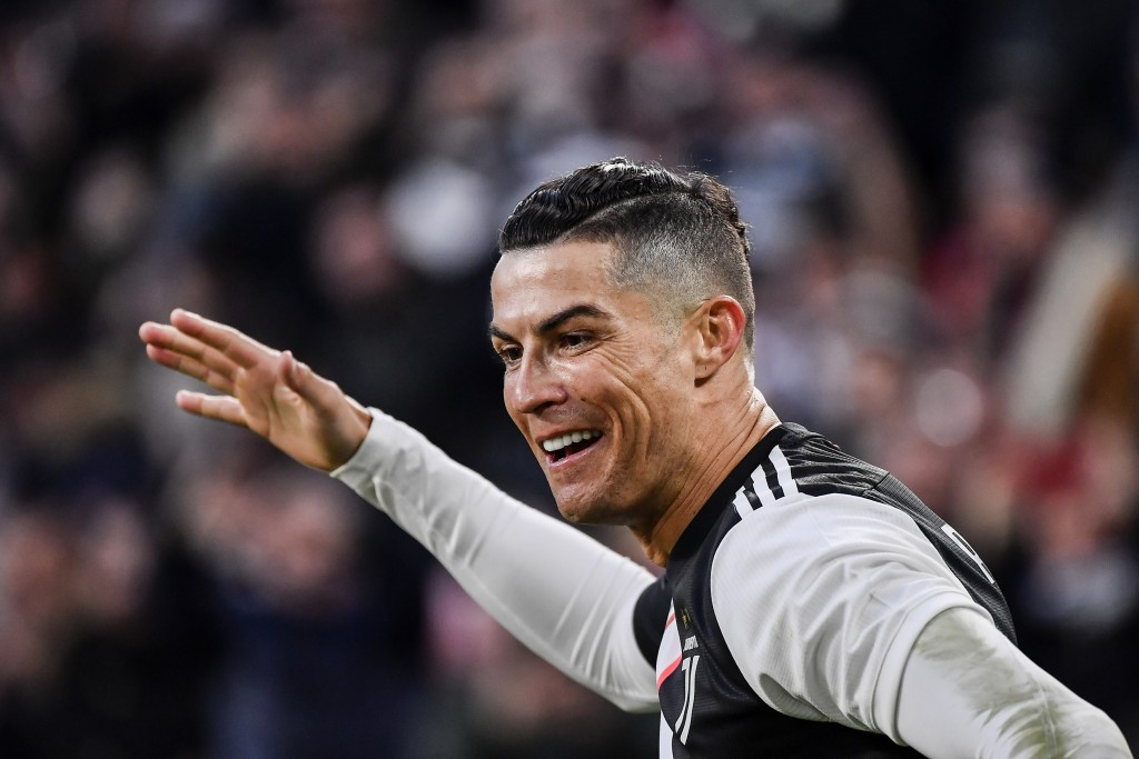 Juventus' Cristiano Ronaldo celebrates after scoring during an Italian Serie A soccer match between Juventus and Cagliari at the Allianz Stadium in Tu...