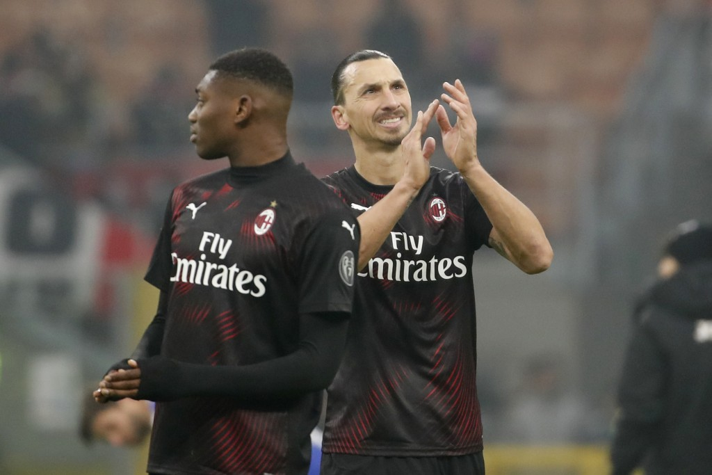AC Milan's Zlatan Ibahimovic, right, waves fans with his teammate Rafael Leao at the end of the Serie A soccer match between AC Milan and Sampdoria at...