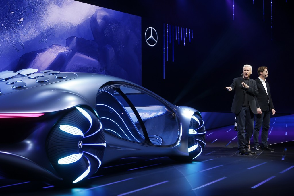 Movie director James Cameron, second from right, who directed movies such as Avatar, talks about the Mercedes-Benz Vision AVTR concept car at the Daim...