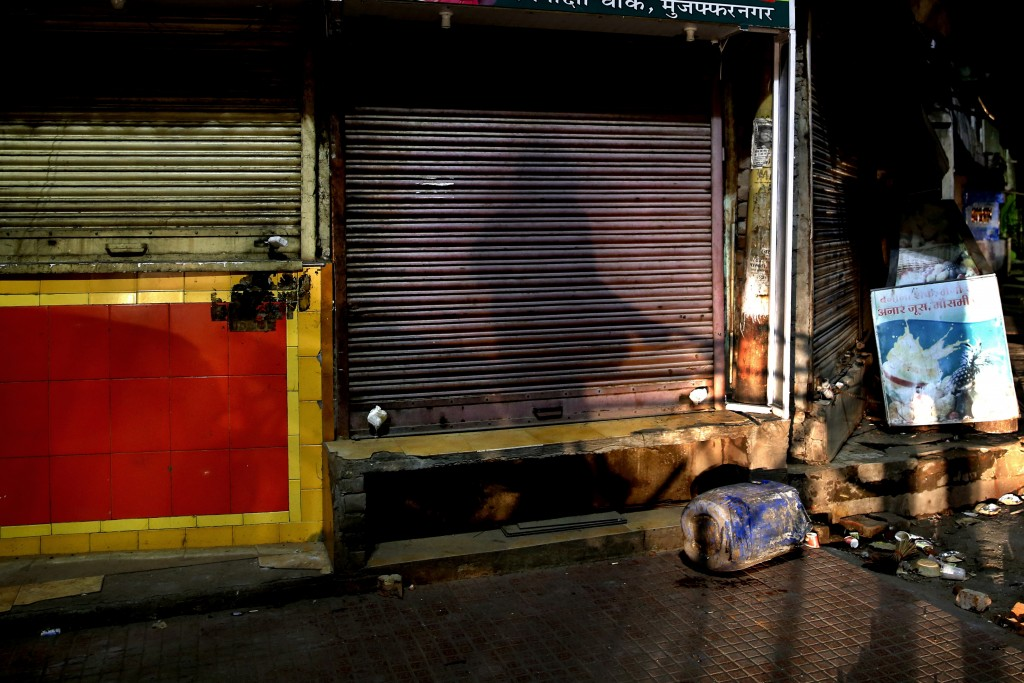 In this Tuesday, Dec. 24, 2019, photo, seals are seen on shops belonging to the people who took part in protests against Citizenship Amendment Act, in...