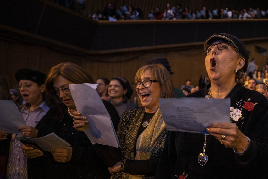 In this Sunday, Jan. 5, 2020 photo, Jewish Orthodox women attend an event celebrating the completion of the 7 1/2-year cycle of daily study of the Tal...