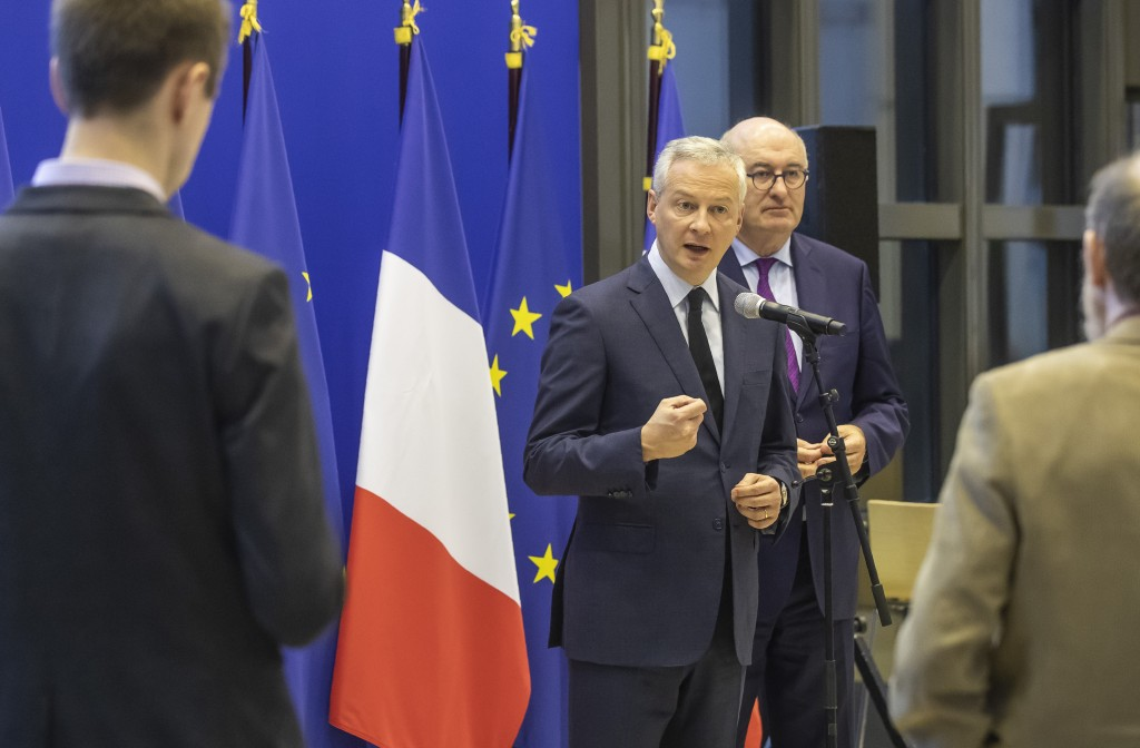 French Finance Minister Bruno Le Maire, left, and European Trade Commissioner Phil Hogan attend a media conference after their meeting in Paris, Tuesd...