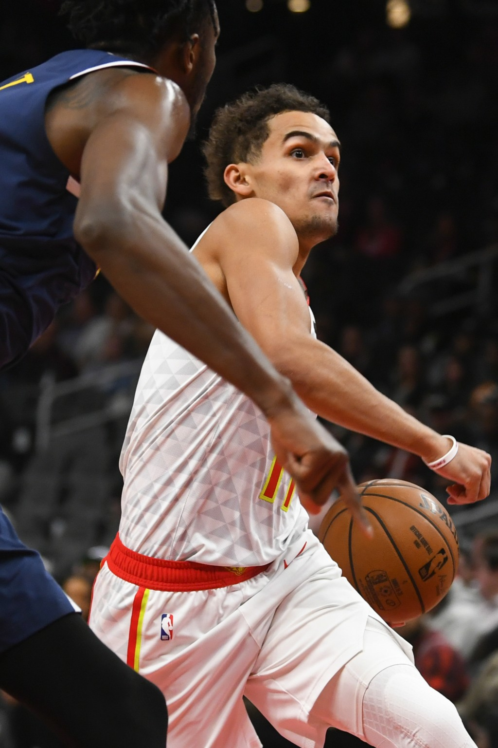 Atlanta Hawks guard Trae Young, right, drives the lane as Denver Nuggets forward Jerami Grant, left, defends during an NBA basketball game Monday, Jan...