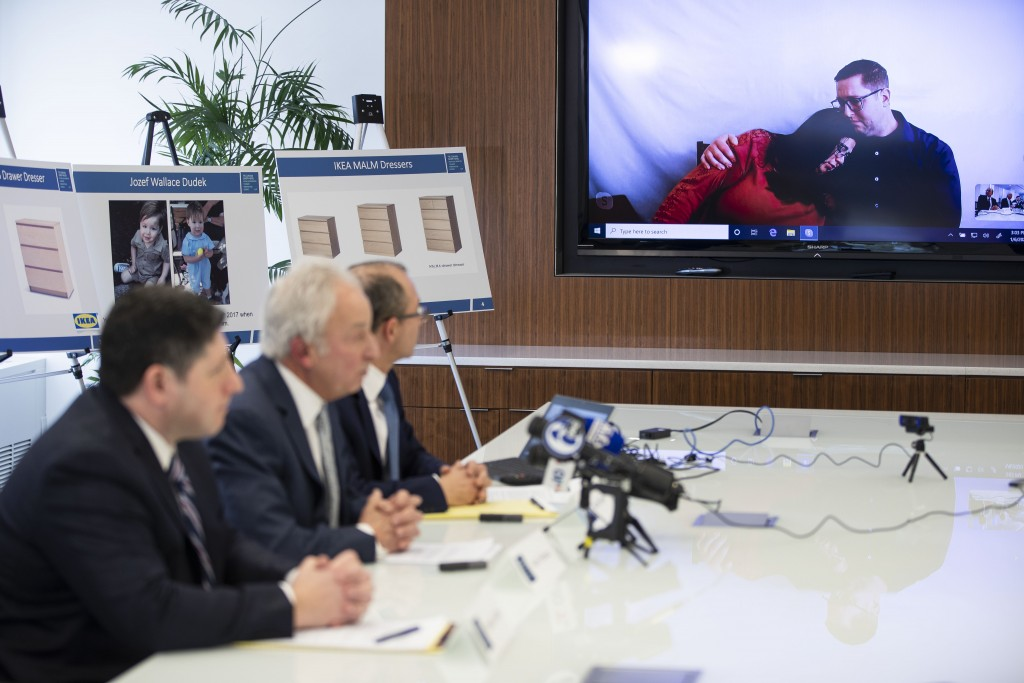 Joleen and Craig Dudek, top right, comfort each other as they join a news conference in Philadelphia via video, Monday, Jan. 6, 2020. IKEA has agreed ...