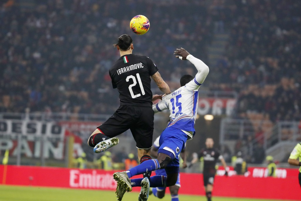 AC Milan's Zlatan Ibahimovic, left, jumps for the ball with Sampdoria's Omar Colley during the Serie A soccer match between AC Milan and Sampdoria at ...