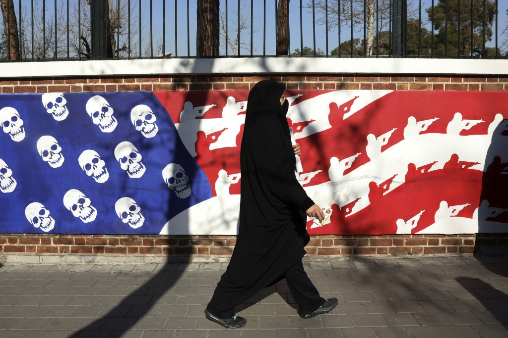 A mourner walk back from a funeral ceremony for Iranian Gen. Qassem Soleimani and his comrades, who were killed in Iraq in a U.S. drone attack on Frid...