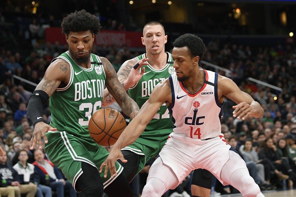 Boston Celtics guard Marcus Smart (36), forward Daniel Theis (27) and Washington Wizards guard Ish Smith (14) battle for the ball during the first hal...