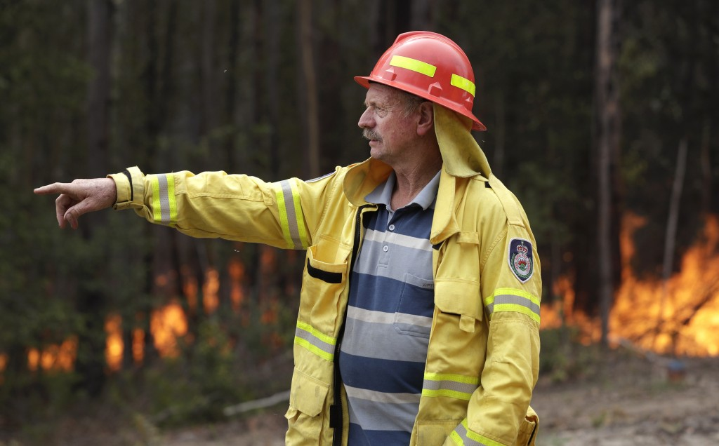 Doug Schutz, the Tomerong Rural Fire Service Captain, oversees a controlled burn near Tomerong, Australia, Wednesday, Jan. 8, 2020, set in an effort t...
