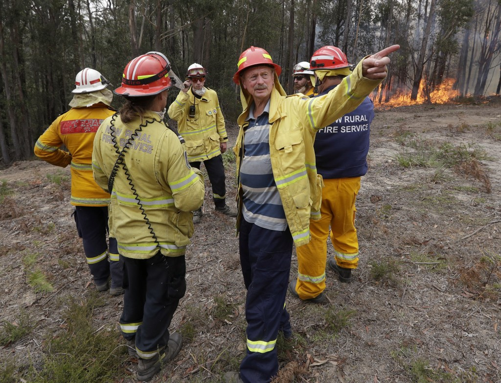 Doug Schutz, 3rd right, the Tomerong Rural Fire Service Captain, oversees a controlled burn near Tomerong, Australia, Wednesday, Jan. 8, 2020, set in ...