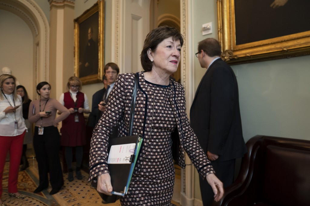 Sen. Susan Collins, R-Maine, arrives for a closed meeting with fellow Republicans about the looming impeachment trial of President Donald Trump, at th...