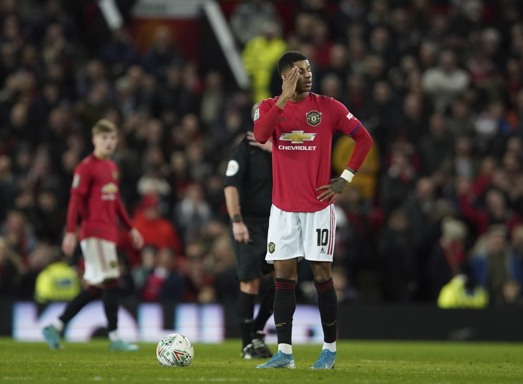 Manchester United's Marcus Rashford waits to restart after Manchester City scored their third goal of the game during the English League Cup semifinal...