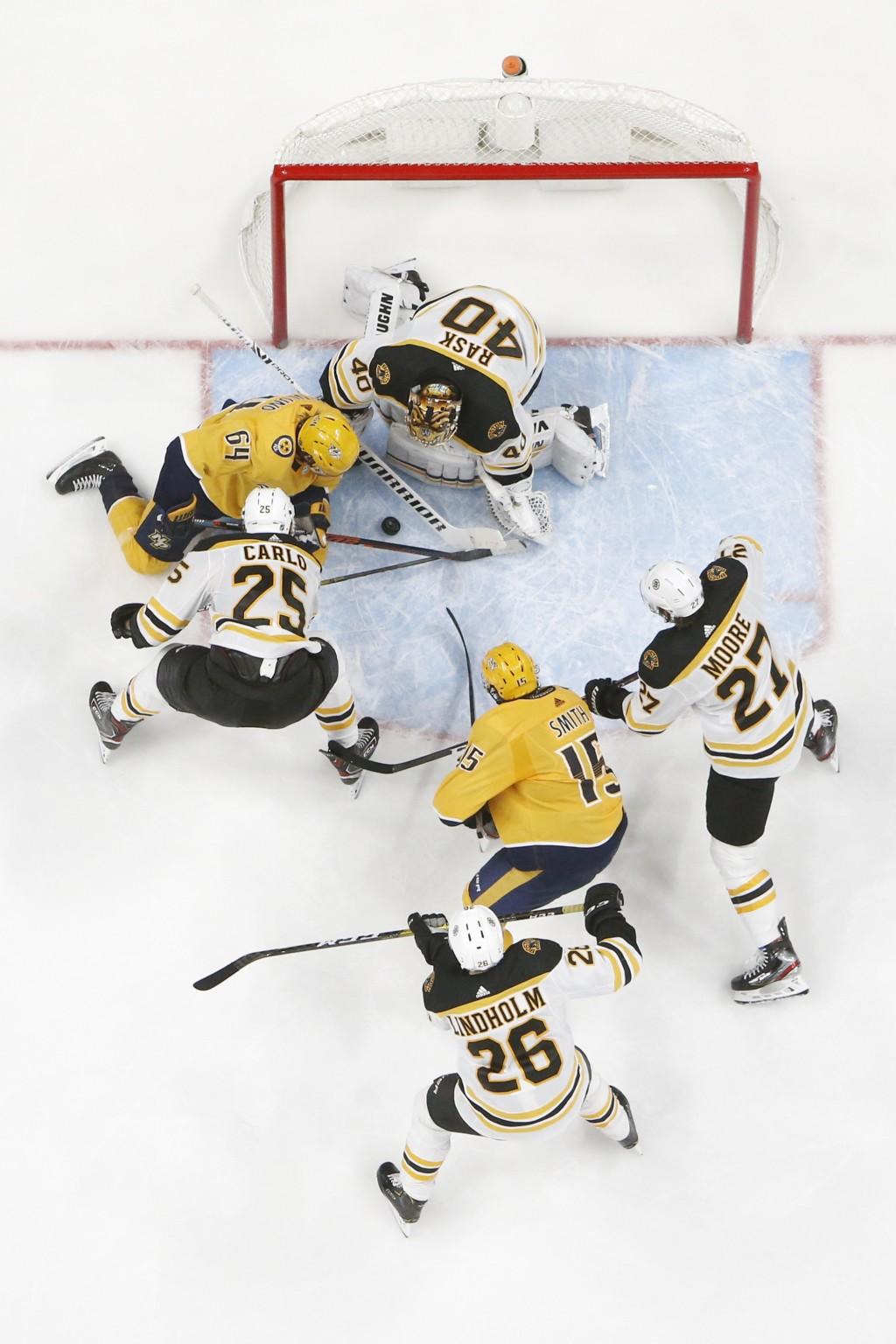 Nashville Predators center Mikael Granlund (64), of Finland, scores a goal against Boston Bruins goaltender Tuukka Rask (40), of Finland, in the third...