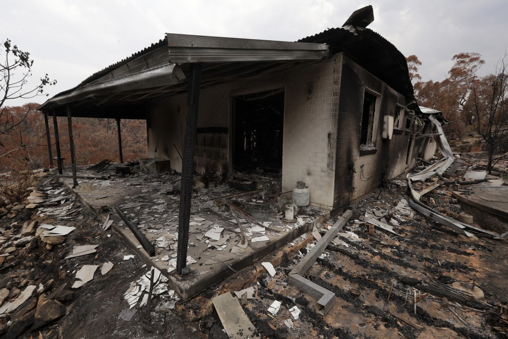 The home of Justin Kam and Helena Wong barely stands after a fire destroyed the house at Balmoral, Australia, Tuesday, Jan. 7, 2020. Kam and Wong buil...