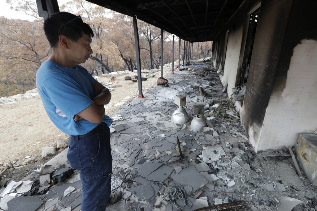 Justin Kam surveys his destroyed home at Balmoral, Australia, Tuesday, Jan. 7, 2020. Kam and his partner built their home with quarter-inch thick rein...