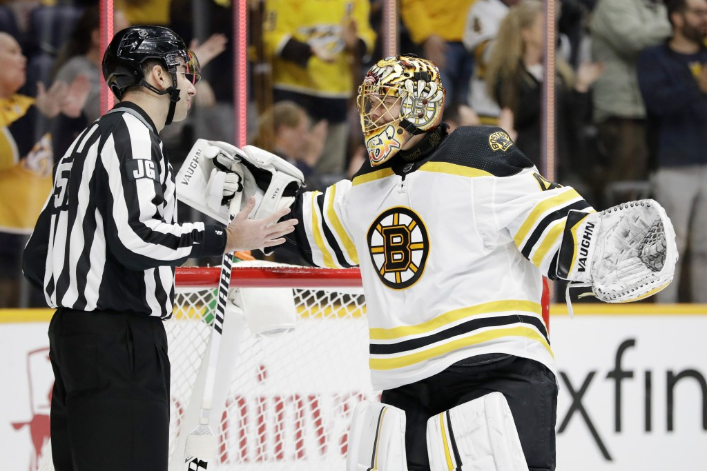 Boston Bruins goaltender Tuukka Rask, of Finland, argues with linesman Andrew Smith, left, after the Nashville Predators scored a goal in the second p...