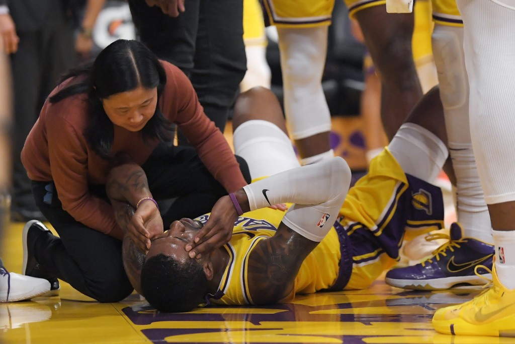 Los Angeles Lakers guard Kentavious Caldwell-Pope is attended to after the was hit in the head while shooting by New York Knicks forward Bobby Portis ...