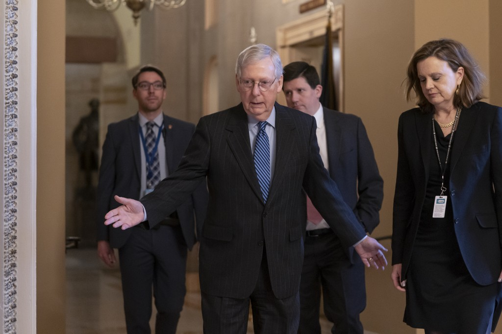 Senate Majority Leader Mitch McConnell, R-Ky., arrives for a closed meeting with fellow Republicans as he strategizes about the looming impeachment tr...