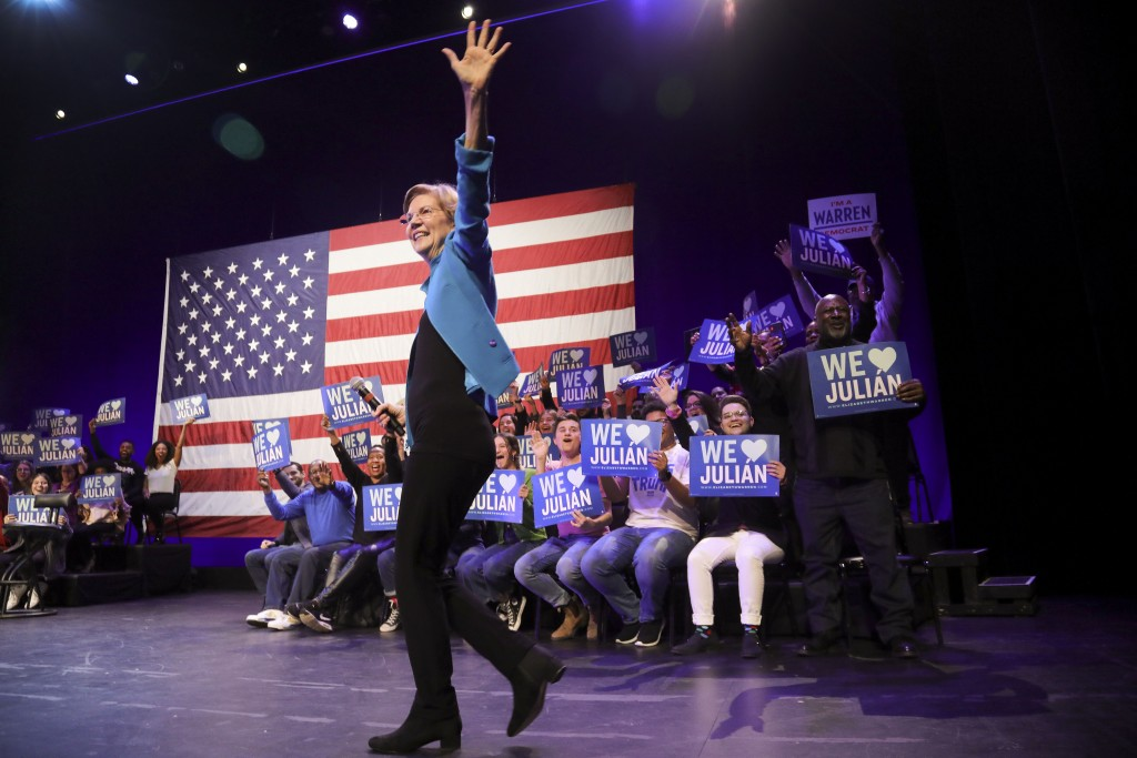 Democratic presidential candidate Sen. Elizabeth Warren, D-Mass., greets supporters during a campaign rally where she appeared with former Secretary o...