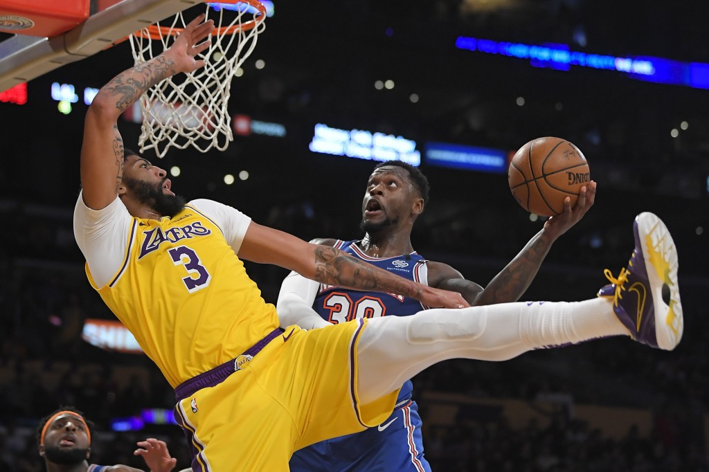 New York Knicks forward Julius Randle, right, shoots as Los Angeles Lakers forward Anthony Davis defends during the second half of an NBA basketball g...