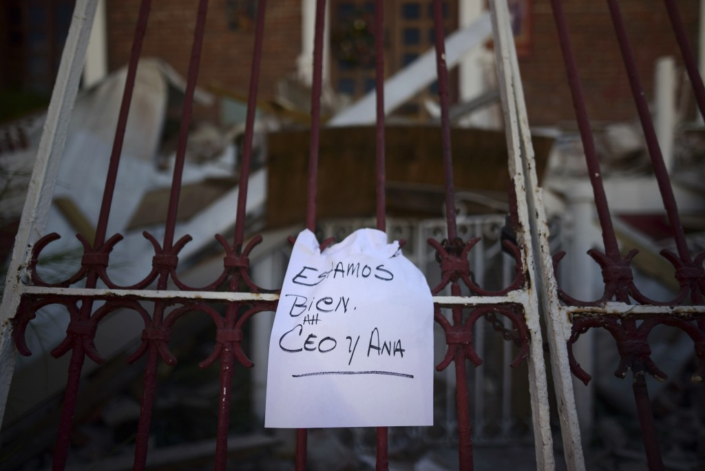 "A note that reads ""We're well. Ceo and Ana,"" hangs on a fence after an overnight earthquake in Guayanilla, Puerto Rico, Tuesday, Jan. 7, 2020. A 6.4-m..."