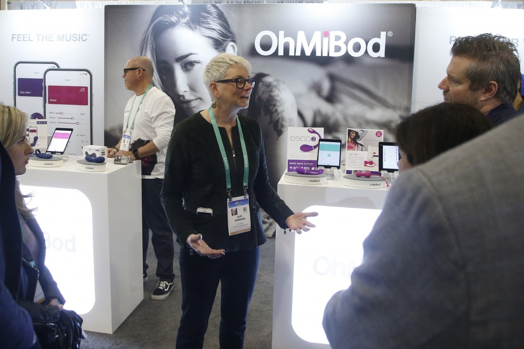 Suki Dunham, co-founder of OhMiBod, talks about her massager devices with app capable music located in the Health & Wellness area during the CES tech ...