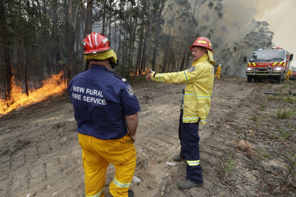 Doug Schutz, right, the Tomerong Rural Fire Service Captain, oversees a controlled burn near Tomerong, Australia, Wednesday, Jan. 8, 2020, set in an e...