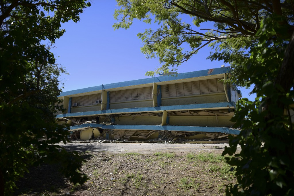 The Adripina Seda public school stands partially collapsed after an earthquake struck Guanica, Puerto Rico, Tuesday, Jan. 7, 2020. A 6.4-magnitude ear...