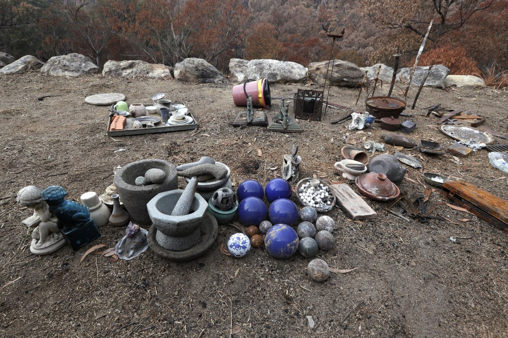 Objects found in the rubble of the home of Justin Kam and Helena Wong are laid out after a fire destroyed their house at Balmoral, Australia, Tuesday,...