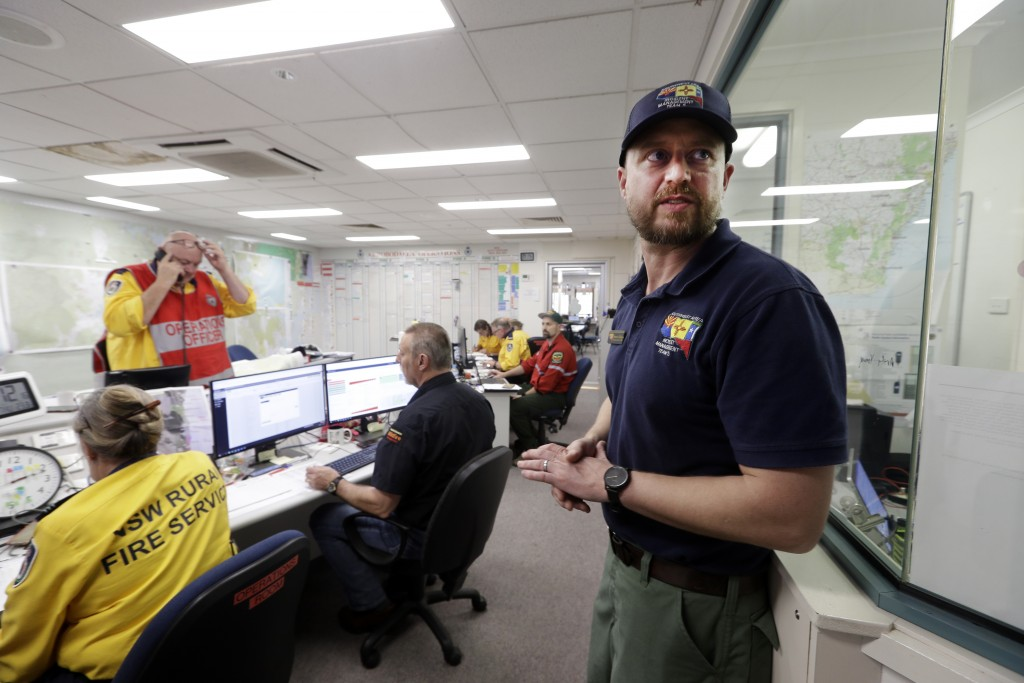 In this Thursday, Jan. 9, 2020, photo, Terrance Gallegos, right, operations section chief at Santa Fe National Forest in the U.S., works in the situat...