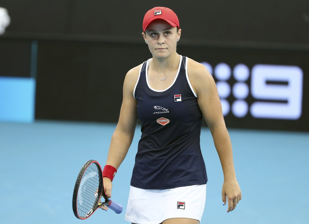 Ashleigh Barty of Australia reacts after missing a shot during her match against Jennifer Brady of the United States at the Brisbane International ten...